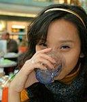 128px-Woman_drinking_water